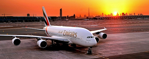 Emirates airplane on the tarmac at sunset